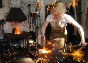 Annabelle Bradley at work on the forge in Malham